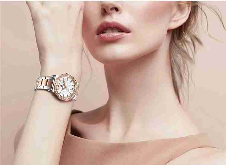 A woman wearing Kademan 829 two tone rose gold luxury gift watch for ladies