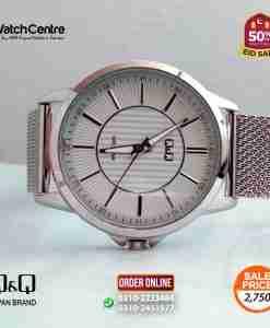 q&q by citizen japan QB66J201Y model mesh strap silver dial men's simple analog dress watch